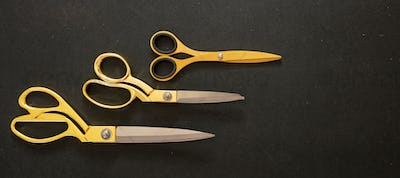 Scissors set gold on black background, top view