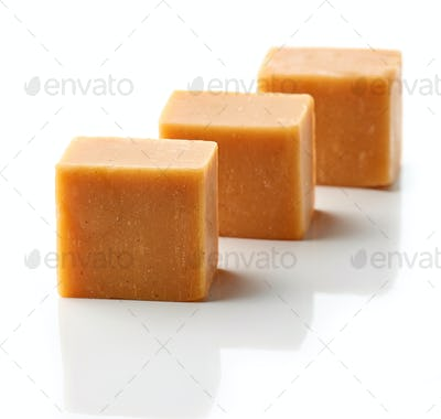 caramel candies on a white background
