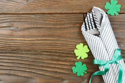 Flat lay view at St. Patricks day set with silverware fork, spoon and napkin