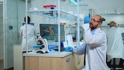Multiethnic team of scientist working in medical laboratory