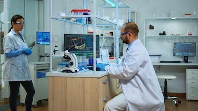 Scientist using microscope cheching virus development