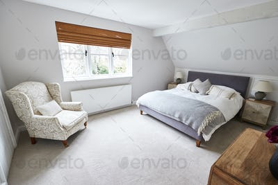 Interior View Of Beautiful Bedroom With Soft Furnishings In Family House