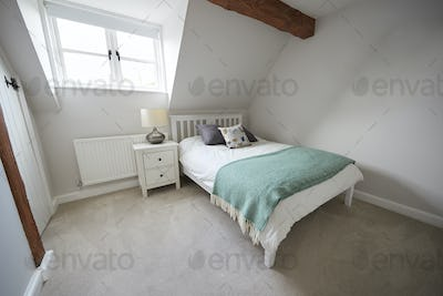 Interior View Of Beautiful Bedroom With Soft Furnishings In Family Home