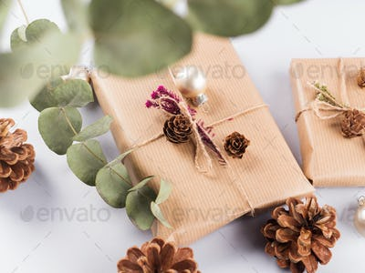 Christmas festive wrapped presents, pine cones