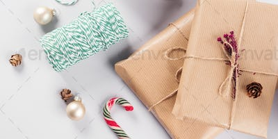 Xmas wrapped gifts stack and green twine