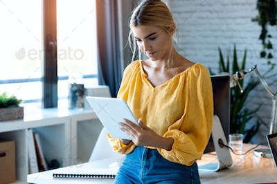 Smart freelance business woman seller working with digital tablet in her startup small business.