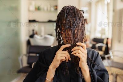Female customer poses in hairdressing salon