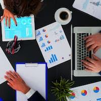 Business people having meeting analysing financial statistics