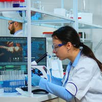 Microbiologist working for new vaccine in modern laboratory