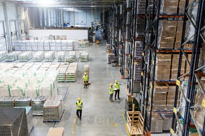 Workers during work in warehouse, view from above