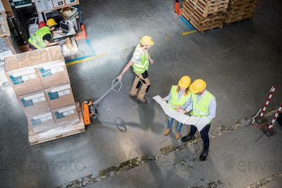 Group of warehouse workers at work, above view