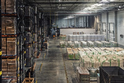 Huge distribution warehouse with high shelves, view from above