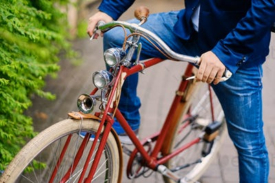 Close up image of a man on a retro bicycle.