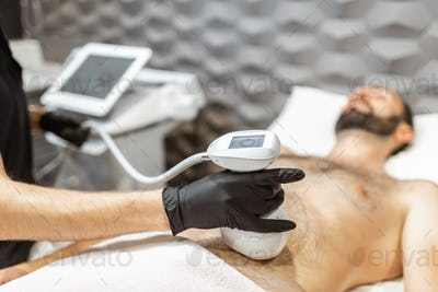Ultrasound liposuction procedure for a male client