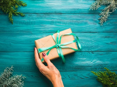 Dark green christmas background with gift box