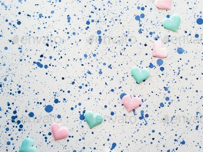 Pastel color hearts on abstract background