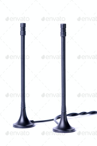 Close-up two black antennas with wires