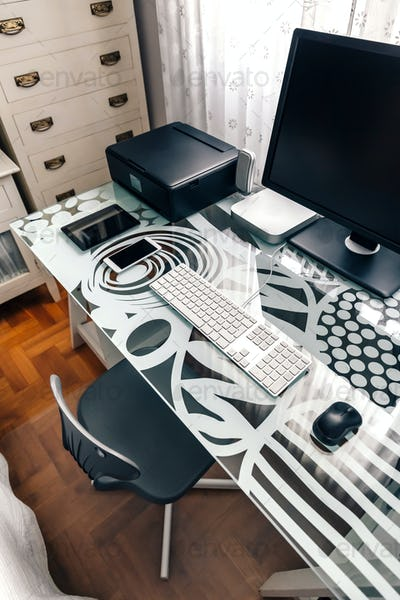 Workstation with table, chair, computer and printer
