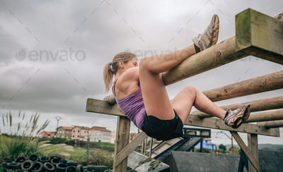 Participant in a obstacle course doing weaver