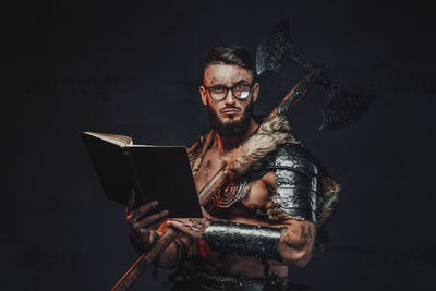 Holding a book and axe scandinavian warrior