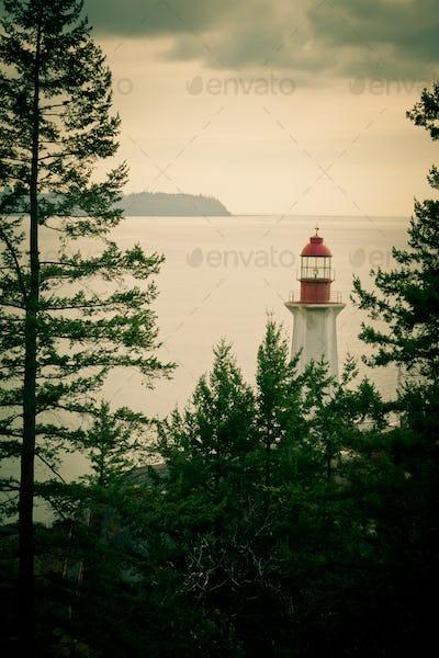 Lo-fi photography lighthouse green BC coast Canada