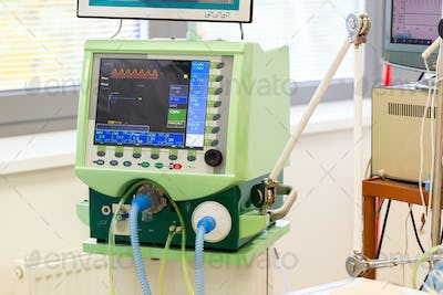 Monitor of pulmonary ventilator in hospital with tubes for air