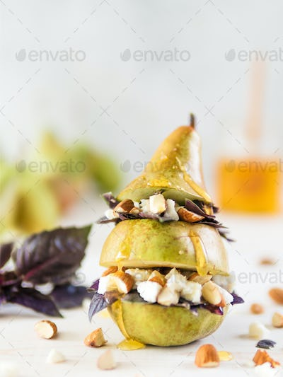 Pear and cheese salad with basil, nuts, honey