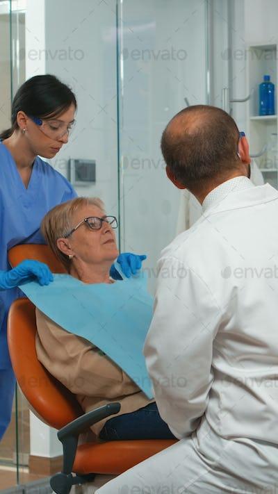 Stomatologist pointing on digital screen explaining x-ray