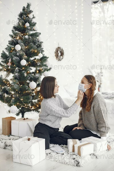 Two women sitting at home with presents