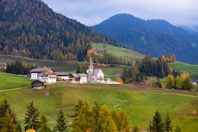 Santa Maddalena church, Dolomites mountains in magic autumn colors