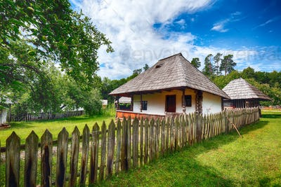 View of traditional romanian peasant houses in Transylvania, Romania.