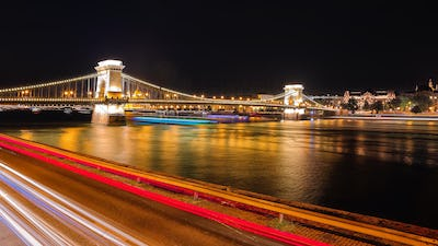 Budapest city night scene. View at Chain bridge, river Danube and famous building of Parliament