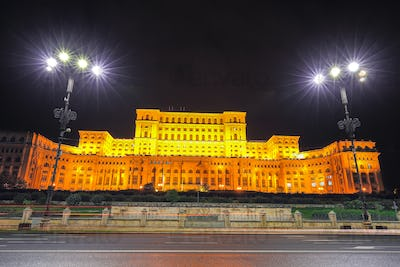 Dramatic evening view of Palace of the Parliament Bucharest city