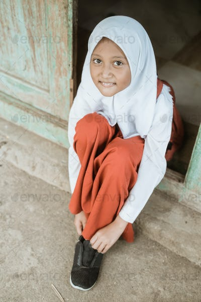 indonesian primary school student getting ready to school in the morning