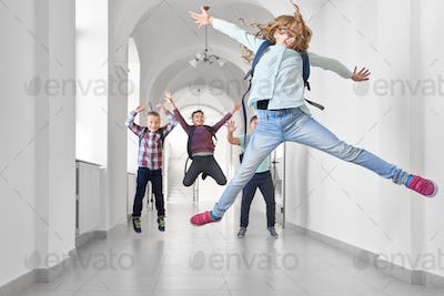 Blonde school girl jumping up and rising up