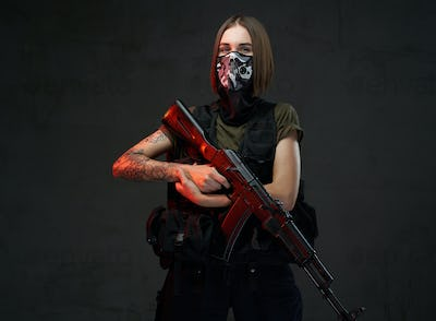 Female soldier weared with mask and holding ak74 rifle