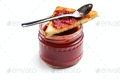 toast with jam in glass jar