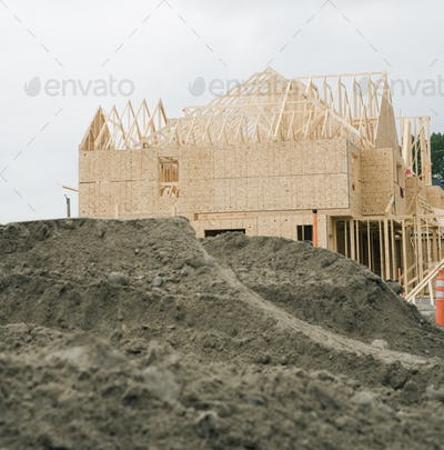 Wooden building frame on construction site.