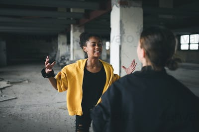 Teenage girl attacked by thugs in abandoned building, gang violence and bullying concept.