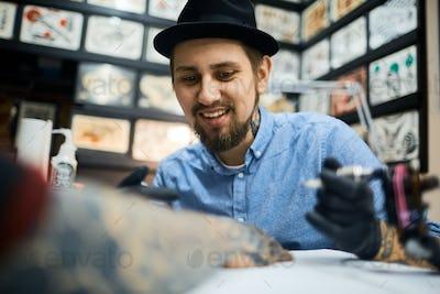 Working as tattooer