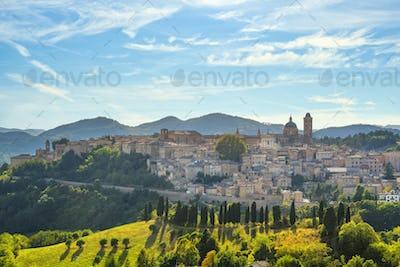 Urbino city skyline and countryside landscape. Marche region, Italy.