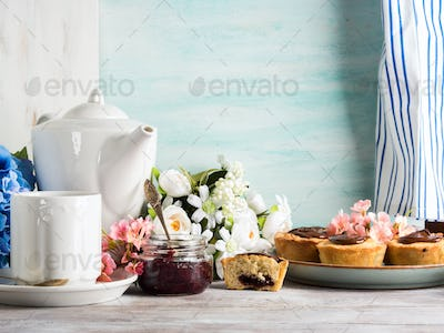 Breakfast table setting with white crockery flower