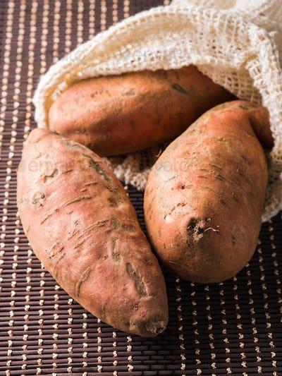 Sweet potato tubers in a reusable cotton bag