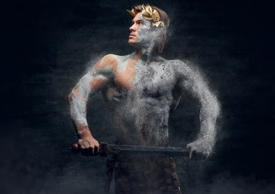 Ancient male athletic warrior with sword.