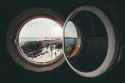 A cityscape through the round window