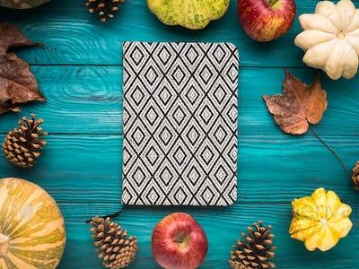 Notebook on green autumn background
