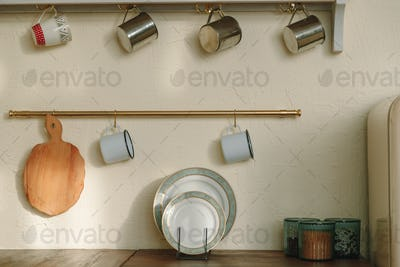 cups and dishes in the modern kitchen, organizing space