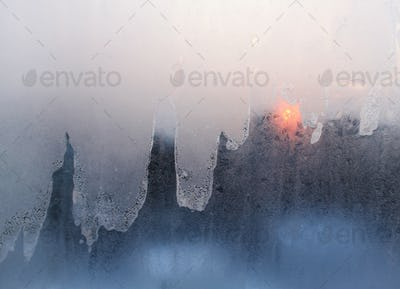ice and sun on winter windowpane