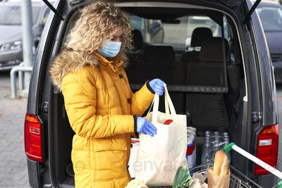 Woman packing bags after shopping during pandemic