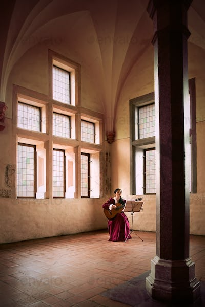 Woman playing guitar in Malbork Castle.